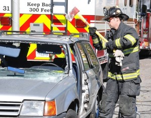 Firefighter Jon Ayotte performs a vehicle extraction demonstration.
