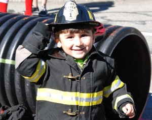 Christopher Franca, 3, gets the chance to sport a kids-size firefighter uniform.
