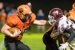 Marlborough captain Lou Vigeant looks to hold off Algonquin defender Will Johnston Photo/Jeff Slovin