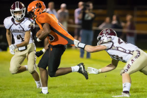 Algonquin's Rio Ferguson tries to pull down Marlborough's JJ Jarmman by his jersey Photo/Jeff Slovin