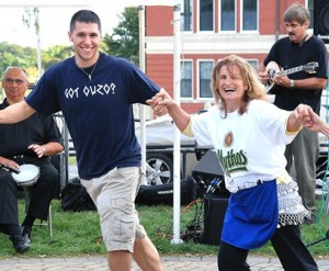 Monthe Lofos and Nikki Beander, both parishioners of Sts. Anargyroi Church, dance along with live music at last year's Grecian Festival.