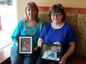 Cheryl Juaire (left) and Kathy Leonard with photos of their sons. Photo/Valerie Franchi