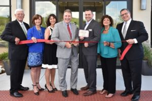 Among those present for the ribbon cutting ceremony at the new Hilton Garden Inn in Marlborough are City Council President Edward Clancy; Karen Chapman, president, Corridor Nine Area Chamber of Commerce; Donna Libby, director of sales at Hilton Garden Inn Boston/Marlborough; Timothy Hippensteele, general manager of the Hilton Garden Inn Boston/Marlborough; Susanne Morreale Leeber, Marlborough Chamber president and CEO; and City Councilor Joseph Delano. Photo/Andy Weigl of Weigl Photography
