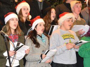 Marlborough High School Mixed Chorus singers perform a holiday tune.