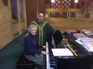 Judy McManus and Father Francis O'Brien.