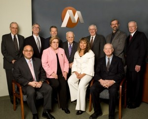 Rick Bennett, the president and CEO of the Marlborough Savings Bank (back, third from left) with the bank's Board of Directors. (seated, l to r):  Sem Aykanian, Fatinha Kerr, Carol Sanchez, and John Sullivan. (standing, l to r): Israel Hurwitz, Alfred Weaver, Bennett, John Noble, James Campbell, Nicholas Kofos, and Lee Chaplin. Photo/Submitted