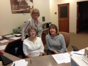 Council on Aging Director Trish Pope (standing) and Linda Maher (left), a volunteer at the senior center, welcome Kathy Murphy, the new director of volunteers. (Photo/submitted)