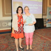 2017-2018 Rotary District 7910 Governor Karin Gaffney (left) presents Marlborough Rotarian Lynn Faust with the glass Rotarian of the Year award. Photo/submitted