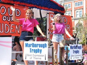 Marlborough High School Music Department students ride a float with signs proclaiming pride for them and music, which won the Marlborough Trophy for best expression of parade theme.