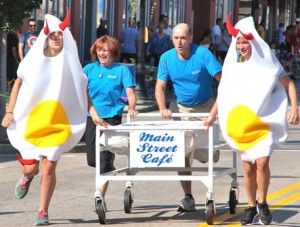 Main Street Café owners Mary and Randy Scott (center) take a break from the breakfast shift with (l to r) Maddy Plante and Rachel Curley costumed as deviled eggs.