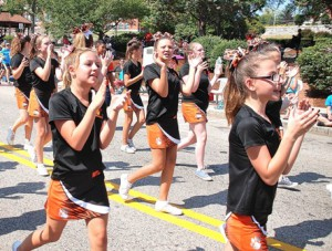 Division 14 cheerleaders display their spirit as they march with other Marlborough Youth Football and Cheer teams.