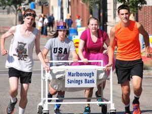 Finishing a close third-place in 1:56 is the team sponsored by Marlborough Savings Bank, consisting of Marlborough High School Cross Country runners (l to r) Logan Cochran, Emily Dickson, Elizabeth Smith and Spencer Geary.