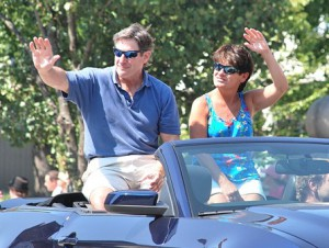 Darren McLaughlin and his wife, Laura, ride in a convertible as he's honored as the grand marshal.