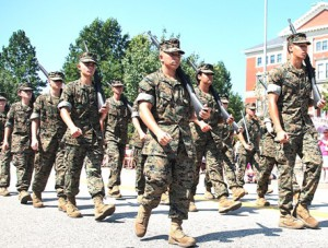 Marching in the Marlborough Labor Day Parade for the first time are U.S. Marine Corps JROTC cadets of Assabet Valley Regional Technical High School, led by Chief Warrant Officer 3 Randolph P. Mann.