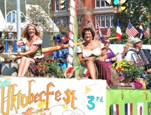 Jackie Smith, the Marlborough Regional Chamber of Commerce program and event manager, and Susanne Morreale Leeber, president and CEO, promote Oktoberfest to be held downtown Saturday, Oct. 3, the second of a three-day Heritage Weekend. Deemed by the judges as the best overall float, it won the Grand Marshal trophy.