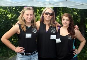 (l to r) Volunteer Brittany Vermilyea, 15, volunteer coordinator Janis White, 37, and volunteer Stephanie Haskins, 14, pose for a photo.
