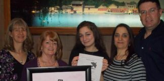Aurora Gigliotti of Hudson, her parents Luisa Basile and Luigi Gigliotti, Diane Hoff, art teacher from the David J. Quinn Middle School in Hudson, and Laura Koester, contest chair