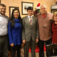 Contest winner Izam Karukappadath (center) with his parents Mili and Ilyas Karukappadath (left), King Lion John Mazza and Speech Contest Chair Laura Koester (right)