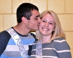 Avery Bonina kisses Carli Sherman after they were named Class Couple by their classmates. Photo/Ed Karvoski Jr.