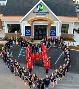 "Marlborough Savings Bank and North Middlesex Savings Bank employees form an ""H"" and a heart in front of the Marlborough Savings Bank Hudson location before visiting downtown. Photo/submitted"