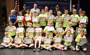 Marlborough Cadets with officials from the Middlesex Sheriff's Office and city officials Photos/submitted