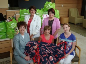 On hand for the recent Courtyard by Marriott blanket donation for the patients of the Cancer Center at Marlborough Hospital were (standing, l to r) Mary Simone, Marriott general manager and Candra Szymanski, interim president and CEO of Marlborough Hospital; and (seated, l to r) Tamara Colpack, area director of sales for the Marriott, patient Jean Francolini, and Heather Lannon, RN, BSN, OCN, an oncology nurse at Marlborough Hospital.
