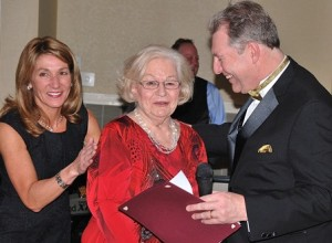 Longtime community leader Marilyn Perry (center) is named Humanitarian of the Year by Lt. Gov. Karyn Polito and Mayor Arthur Vigeant.