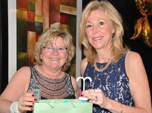 Donna Barberio and Wendi Butler display a Bernardi sterling silver ring and a pair of hoop earrings donated for a raffle by Joy-Den Jewelers. The jewelry winners were Simony Allen and Rob Tunnera.