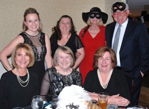 Gathered at the masquerade-themed ball are (back, l to r) state Rep. Danielle Gregoire, D-Marlborough; Peggy Schwarz Ayres, Assabet Valley Regional Technical High School Committee member; Jean Peters; City Councilor Don Landers; (front, l to r) Betsey McKeon; Joan Gregoire and Ella Phillipo.