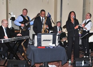 The band Supplemental Income performs in the ballroom.