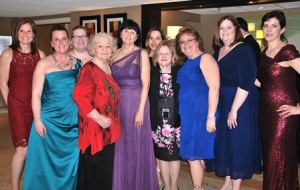 Marilyn Perry (fourth from left), Humanitarian of the Year and a founding member of the Marlborough Junior Woman's Club, poses with current club members (l to r) Recording Secretary J.J. Lynch, School Committee member Katherine Hennessy, City Councilor Kathleen Robey, Ellin Scalese, Mary Wenzel, Vice President Brenda Geary, School Committee member Denise Ryan and Sharon Buckley.