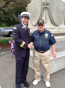 Jeffrey Gogan, the keynote speaker at Marlborough's Memorial Day ceremony, is introduced by Ward 2 City Councilor Robert Page, who is also a member of the Disabled American Veterans local chapter, at ceremony held in Monument Square. Gogan, a veteran of the U.S. Navy, is also a Marlborough Fire Department deputy chief.   Photo/submitted
