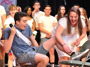 The legs category features Miguel Lopez, Mr. Student Council, getting waxed by Cora Allard, a senior.