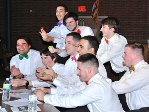 As part of a song-and-dance number, Miss Massachusetts gets marriage proposals from contestants (front, l to r) Gabriel Cuncha, Spencer Geary, Liam Shanahan, Michael Lopez, Cam Plank, (back, l to r) Miguel Lopez, Christian Buckley, Brian Oram and Matthew Cummins.