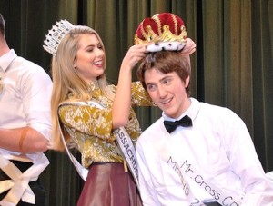 After joking about his towering height during the talent category, Spencer Geary crouches so that Miss Massachusetts Whitney Sharpe can crown him Mr. MHS 2016.