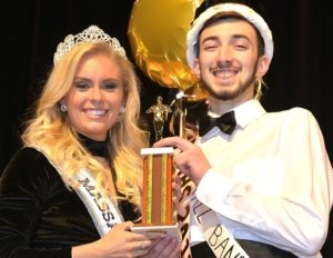 Miss Massachusetts Teen USA 2018, Lexi Woloshchuk, presents the Mr. MHS 2018 trophy to the newly-crowned Austin Wise, who competed as Mr. Jazz Band.