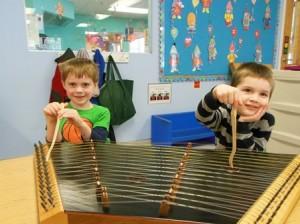 Ryan Voner and Liam Grondine play the dulcimer.