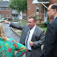 Douglas Bushman guides State Sen. Jamie Eldridge and State Rep. Danielle Gregoire on a tour of the Pleasant Street affordable housing complex. Photo/Dakota Antelman