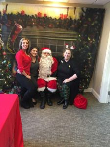 The staff of RTN's Marlborough branch enjoys a moment with Santa. Photo/submitted