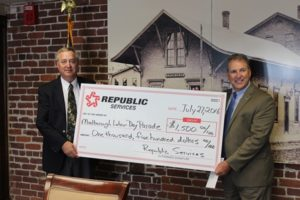 Terry Grady (left), municipal services manager for Republic Services, presents Mayor Arthur Vigeant with a sponsorship for the Marlborough Labor Day Parade Sept. 5. Photo/submitted