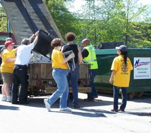 Marlborough Rotarians clean out a trailer of junk at last year's Recycling Day. (Photo/submitted)