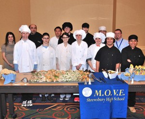 MOVE participants pose with the buffet they prepared.
