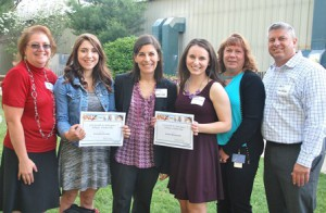 Giselle R. Rodriguez Hologic Scholarship recipients Kailyn Palaima (second from left) and Alysha McGovern (fourth from left) gather with representatives of Hologic, Inc.: (l to r) Brenda Geary, regulatory affairs specialist; Anne Liddy, assistant general counsel, Joyce Bourgeois, senior paralegal, and Mike Carenzo, assistant general counsel.