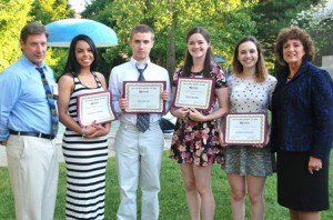 (l to r) Darren McLaughlin, Marlborough Regional Community Foundation president, joins scholarship recipients Andressa Andrade, Ryan Keene, Rachel MacMunn and Allison Caufield, and Susanne Morreale Leeber, Marlborough Regional Chamber of Commerce president and CEO. Not pictured is scholarship recipient Ngam Kim Phan.