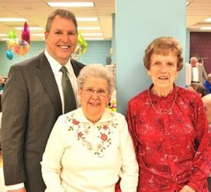 Mayor Arthur Vigeant congratulates the two Senior of the Year recipients, Lydia Whitcomb and Rita Collins. Photo/Ed Karvoski Jr.