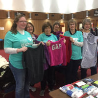 (l to r) St. Stephen Lutheran Church Clothing Giveaway volunteers Liz Greer, Jane Woolsey, Martha Domke, Judy Kellogg, and Lisa Doerr show some of the thousands of free clothing items prior to opening the doors last Saturday morning.