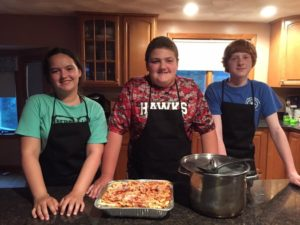 """Samantha (""""Sammy"""") Gogan, Matt Haley and Sam Maston, all of Hudson, show an example of one of their pasta dishes. (Photo/submitted)"""