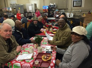 Mark Vital (far right) with AMSA students at the Worcester homeless veterans wait for their holiday breakfast.