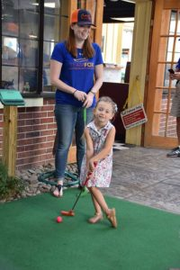 Megan Raiano gives her niece, Juliette Maccioli, the opportunity to go first at the recent Putt Putt for Parkinson's held at Trombetta's Farm in Marlborough. Photos/Cindy Zomar