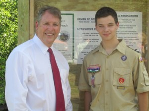 Mayor Arthur Vigeant and Boy Scout Scott Cucinotta, who built the information kiosk at the entrance to the beach.